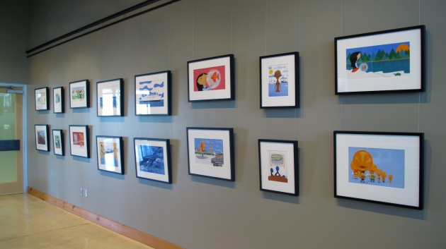 Wide shot of Yaccarino art on gray wall